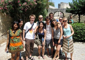 a group of happy students posing for a photo on a cultural visit in France